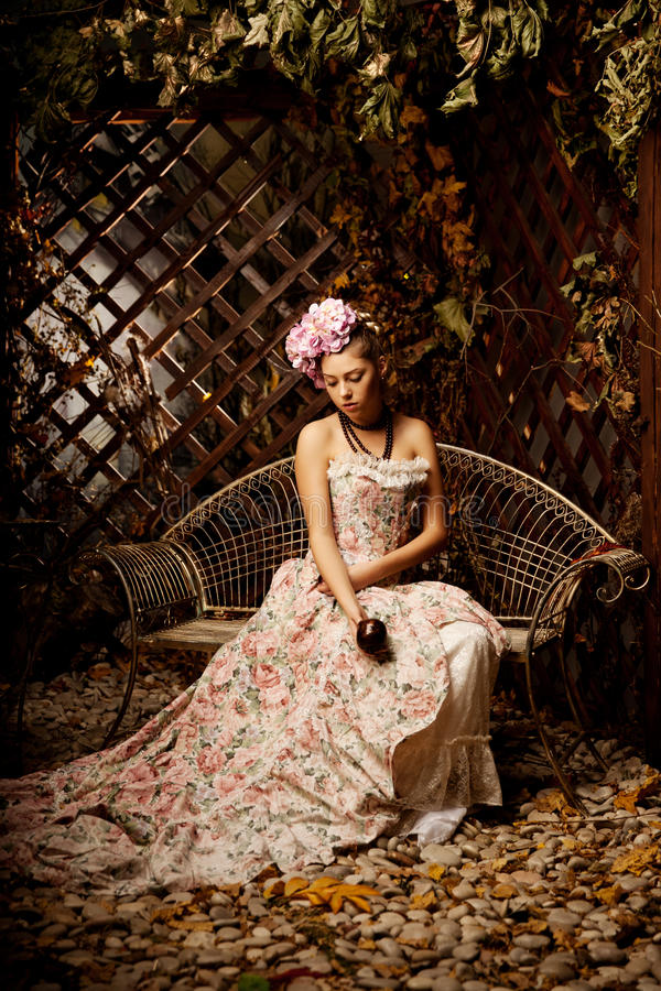 Retro woman. Girl in vintage style with flowers in hairstyle royalty free stock photography