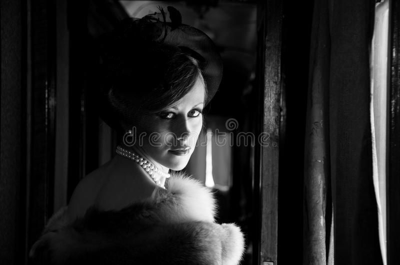 Retro Woman in hat with veil and fox furs royalty free stock images