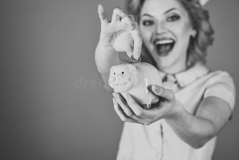 Retro woman hold moneybox, piggy bank for savings. Retro woman save money royalty free stock photography