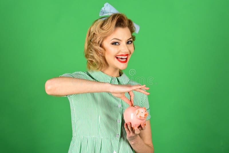 Retro woman hold moneybox, piggy bank for savings. Retro woman save money royalty free stock photos