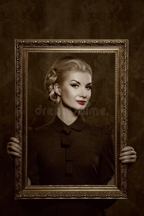 Retro Woman Holding A Picture Frame In Her Hands Stock Photography