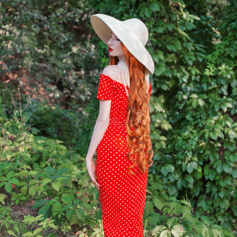Free Retro Woman In Red Polka Dot Dress On Green Summer Background. Vintage Redhead Girl On Background Of Forest With Green Leaves. Stock Photos - 158243033