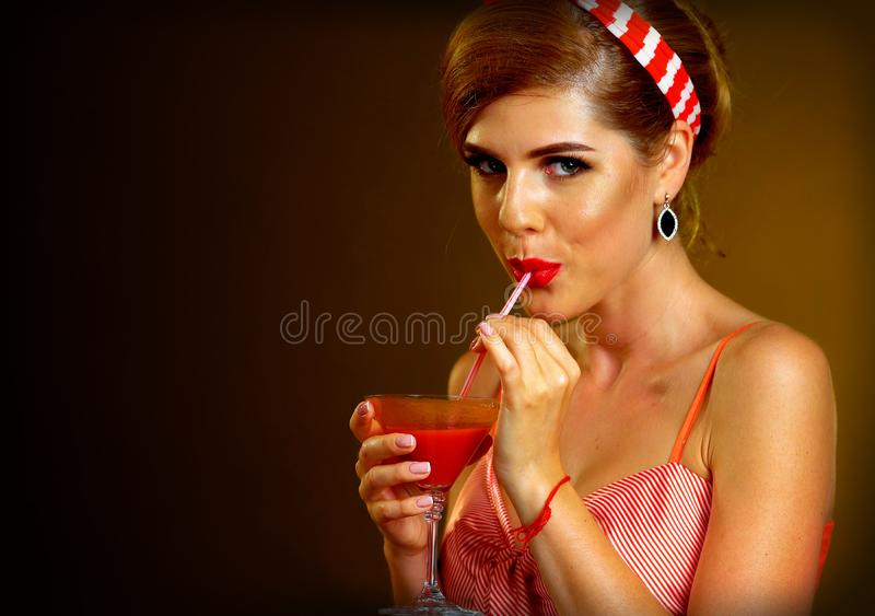 Retro woman with music vinyl record. Pin up girl drink martini cocktail. Girl pin-up retro style wearing red dress on dark background. Illegal alcohol at party royalty free stock photos