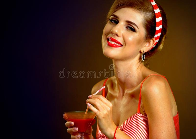 Retro woman with music vinyl record. Pin up girl drink martini cocktail. Girl pin-up retro style wearing red dress on dark background. Free and independent stock image