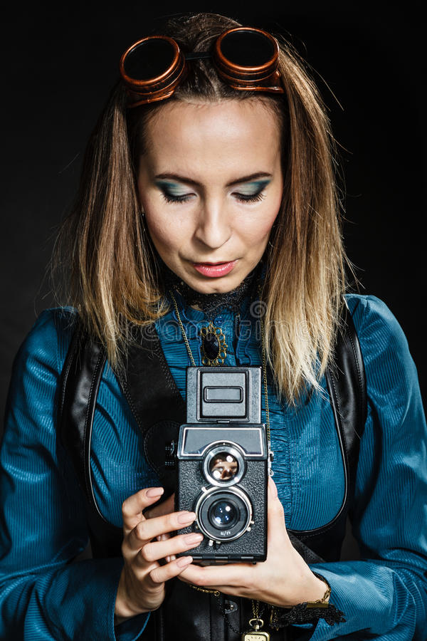 Retro woman with old camera. Steampunk. stock images