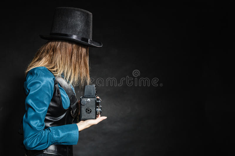Retro woman with old camera. Steampunk. stock photo
