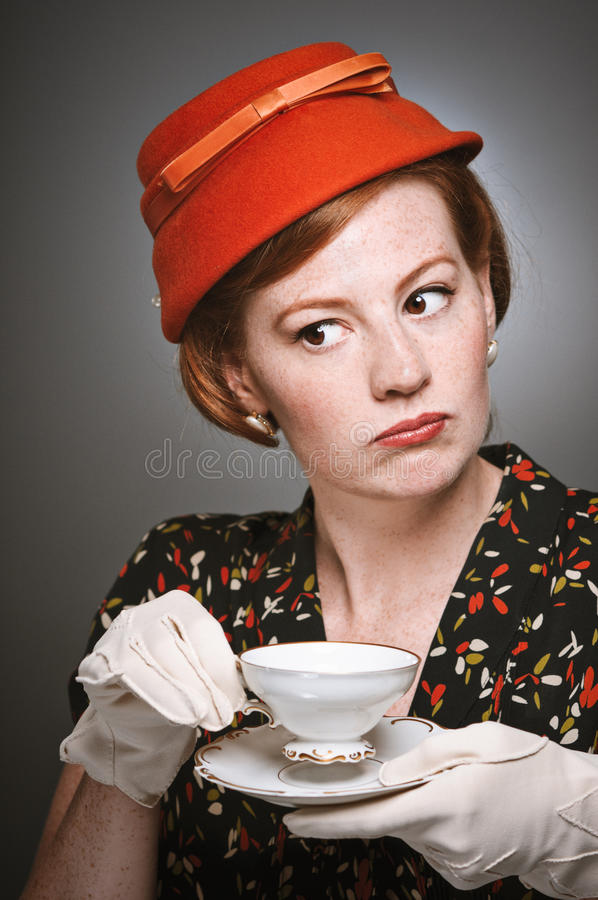 Retro Woman Passing Judgment While Drinking Tea royalty free stock image