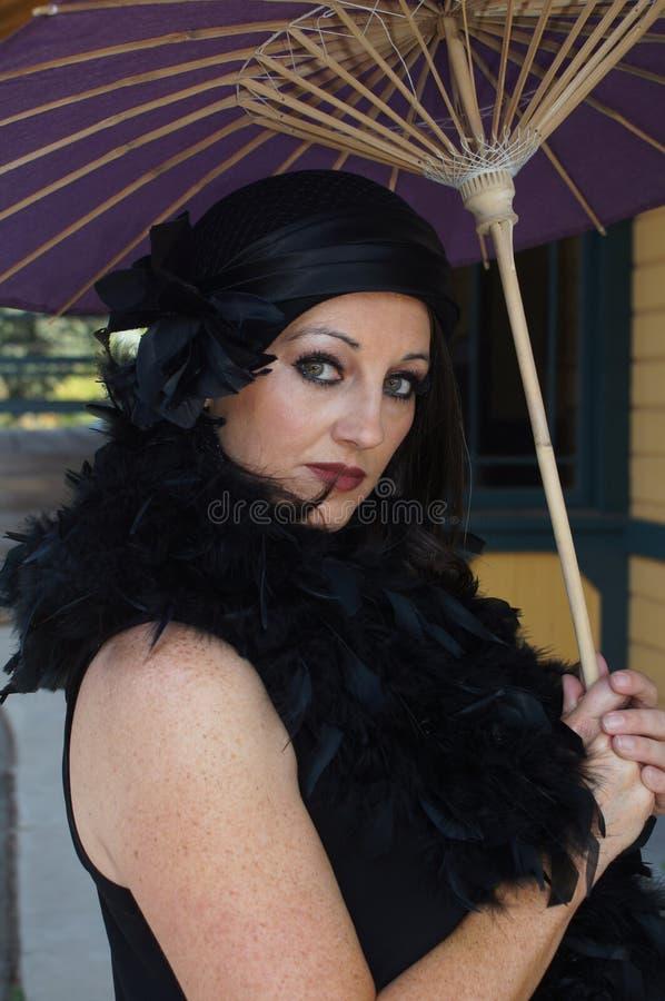 Retro Woman At Train Depot Holding Umbrella Royalty Free Stock Photography
