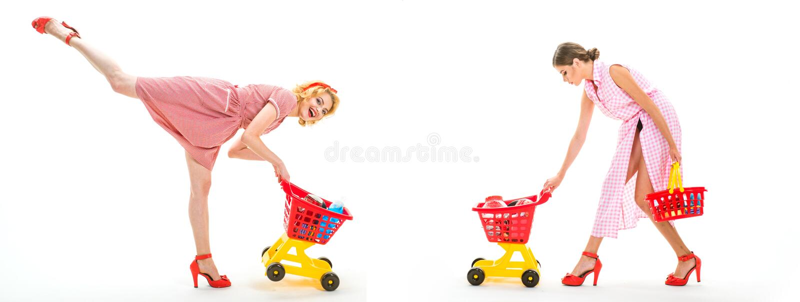 Retro women go shopping with full cart. vintage housewife women going to make payment in supermarket. happy shopping. Girls with full cart. savings on purchases royalty free stock photography