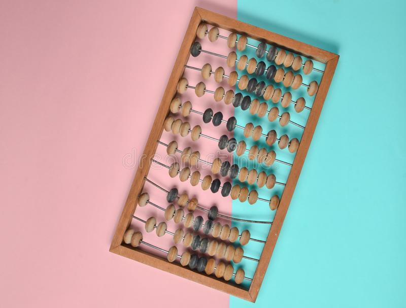 Retro wooden abacus on pastel color paper background. top view. Retro wooden abacus on pastel color paper background. top view royalty free stock images