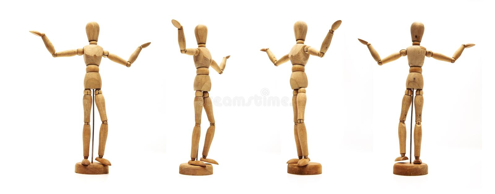 Retro Wooden Dolls Isolated. In different posing royalty free stock photography
