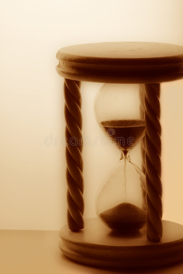 Retro wooden hourglass royalty free stock photography