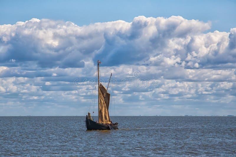 Retro wooden sailing ship sails into the sea royalty free stock photos