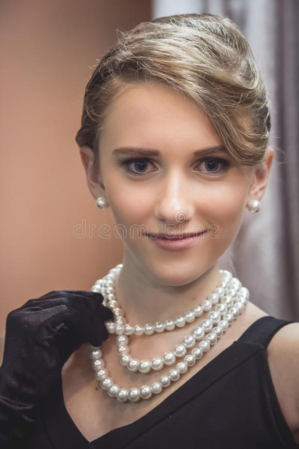 Retro young girl fine art portrait in the style of 1940-s royalty free stock photo