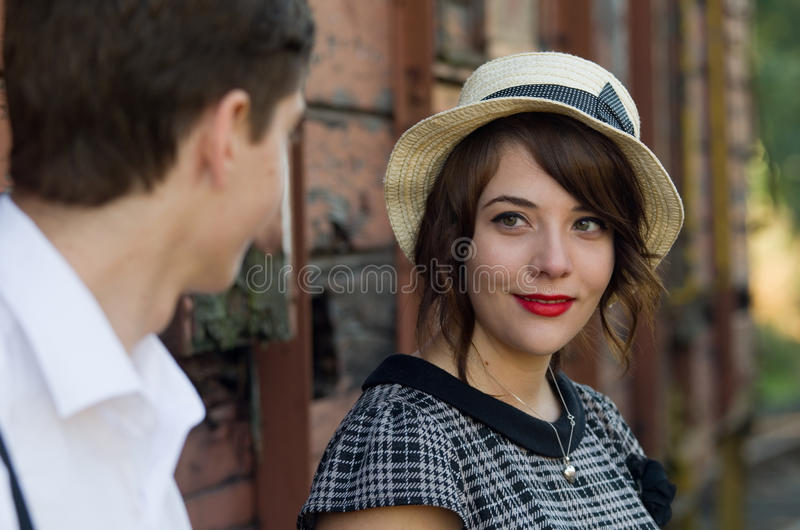 Retro young love couple vintage train setting royalty free stock photo