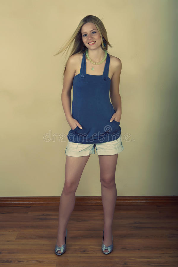 Retro young woman in shorts royalty free stock photos