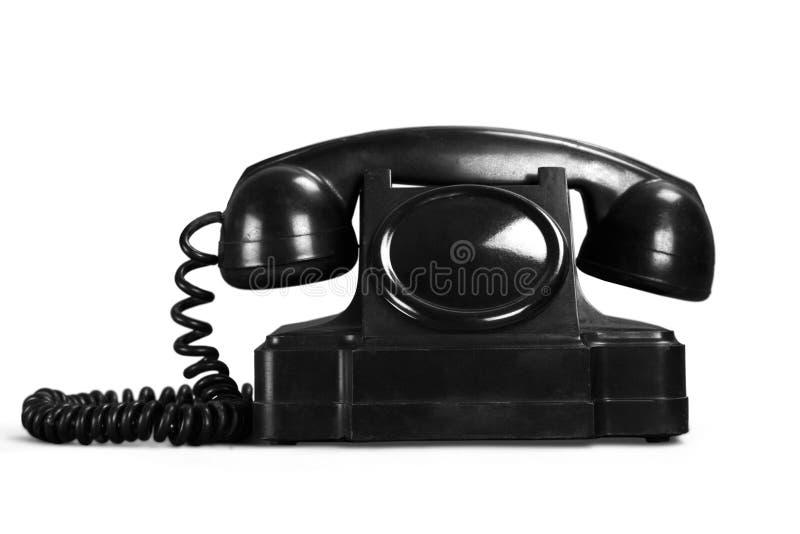 Retro zwarte telefoon op witte achtergrond royalty-vrije stock afbeelding