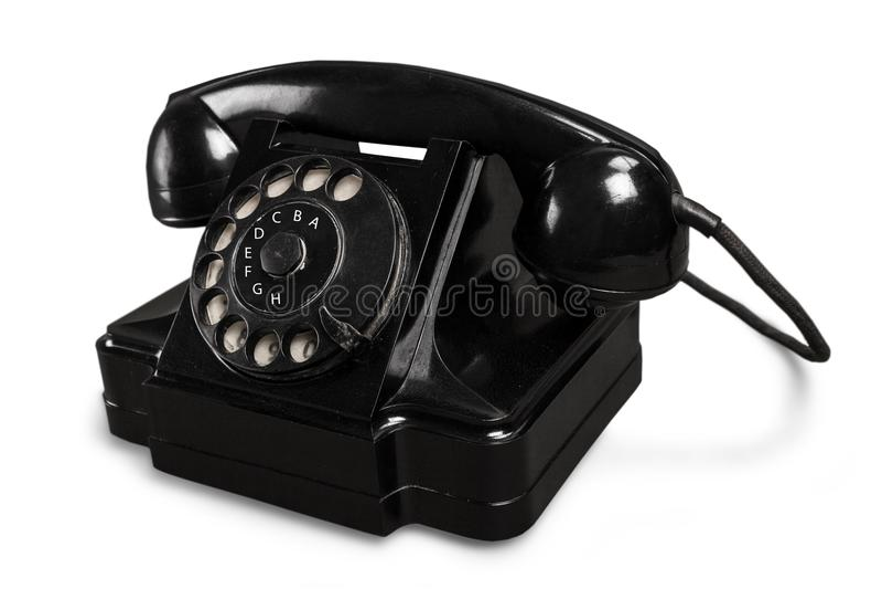 Retro zwarte telefoon op witte achtergrond stock afbeeldingen