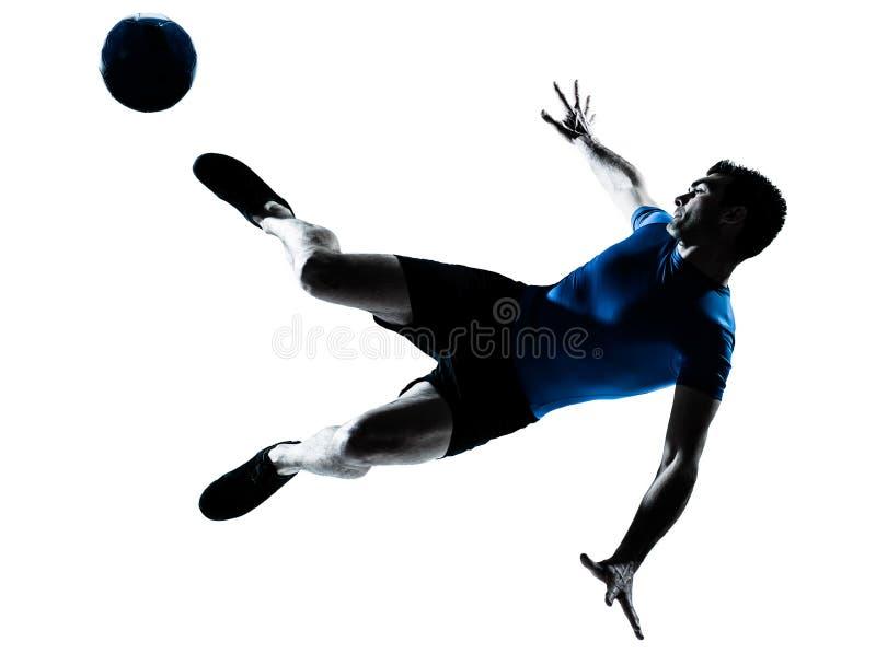 Retroceso con el pie del vuelo del futbolista del fútbol del hombre fotos de archivo