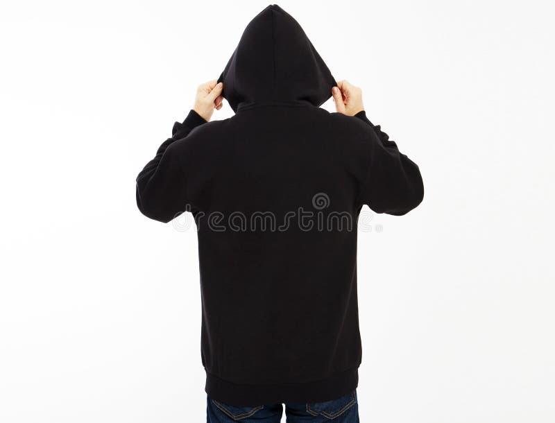 Retrovisione della persona di sesso maschile incappucciata isolata su fondo bianco con lo spazio della copia falso su fotografie stock libere da diritti