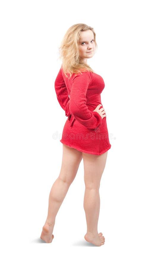 Retrovisione della ragazza sexy in breve vestito rosso fotografia stock