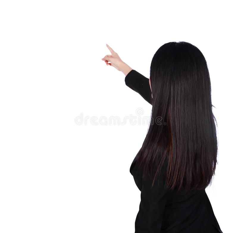 Retrovisione di indicare della donna di affari isolato su un backgro bianco fotografie stock libere da diritti