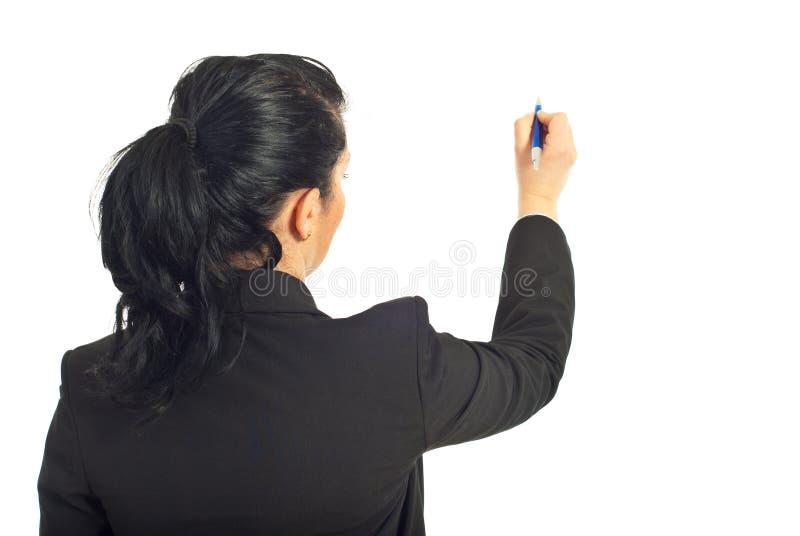 Retrovisione di scrittura della donna di affari sulla copia immagine stock