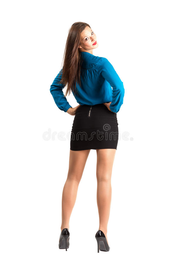 Retrovisione diritta della donna di affari che esamina la spalla immagini stock libere da diritti