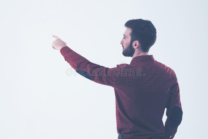 Retrovisione - un riuscito responsabile di una mano indicante sullo spazio in bianco fotografia stock