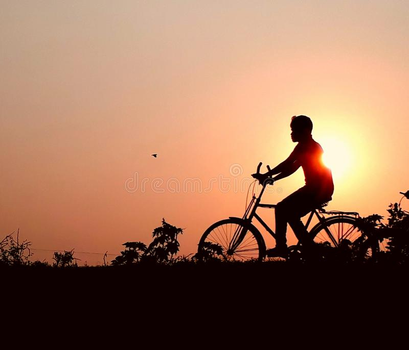 Return to Home. Country roads, cycling, bird, sunset, natyre, background, bangladesh, comilla, photography royalty free stock images