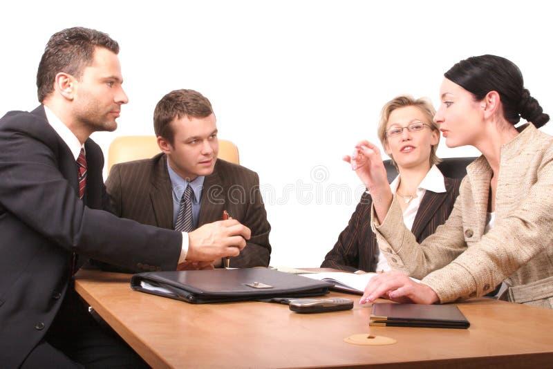 Reunião de negócio de 4 pessoas - 2 fotografia de stock