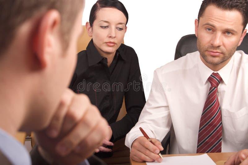 Reunião de negócio de três pessoas fotos de stock royalty free