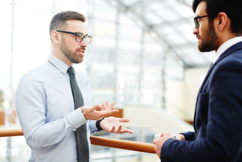 Reunião dos homens de negócios imagens de stock