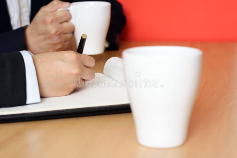 Reunión de negocios de la mañana imagen de archivo libre de regalías