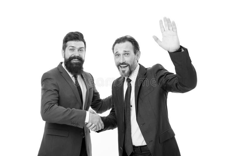 Reuni?n de negocios ?xito del equipo Colaboraci?n y trabajo en equipo hombres de negocios barbudos en traje formal sociedad de lo foto de archivo libre de regalías