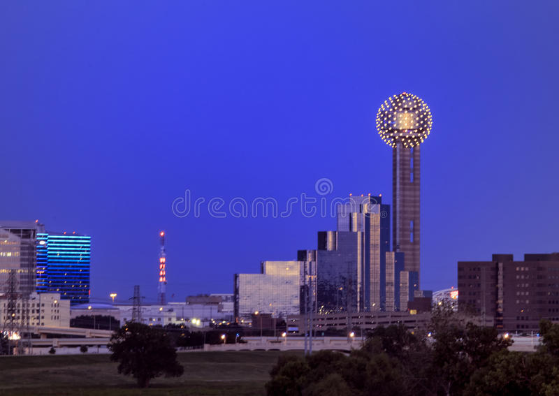 Reunion Tower, Dallas. Pictured is the famous Reunion Tower in Dallas, seen from the Sylvan Bridge to the West of downtown. The tower`s lights are on, the sun stock images