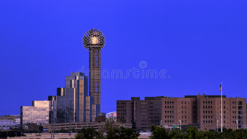 Reunion Tower, Dallas. Pictured is the famous Reunion Tower in Dallas, seen from the Sylvan Bridge to the West of downtown. The tower`s lights are on, the sun stock photos
