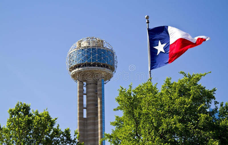 Reunion Tower in Dallas Texas on a Sunrise Spring morning with a. Lone Star Flag stock photography