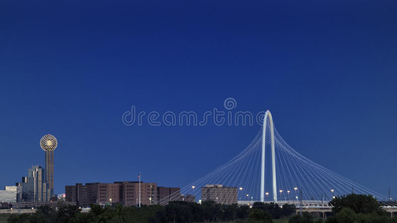 Reunion Tower and Margaret Hunt Hill Bridge, Dallas. Pictured is view of the Reunion Tower and Margaret Hunt Bridge from the Sylvan Avenue Bridge on the West royalty free stock image