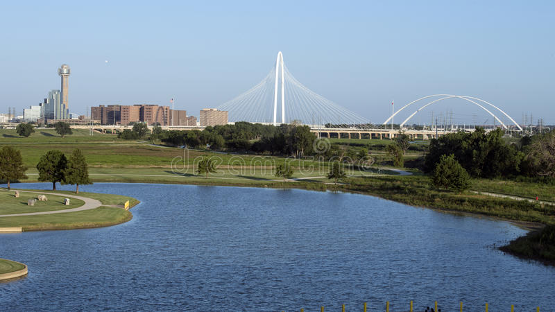 Reunion Tower and Margaret Hunt Hill Bridge, Dallas. Pictured is view of the Reunion Tower and Margaret Hunt Bridge from the Sylvan Avenue Bridge on the West royalty free stock images