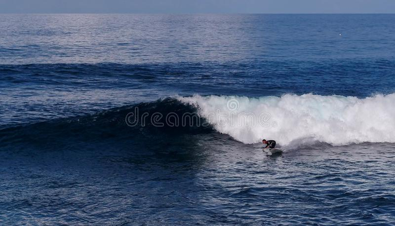 Surfer on fire ! stock image