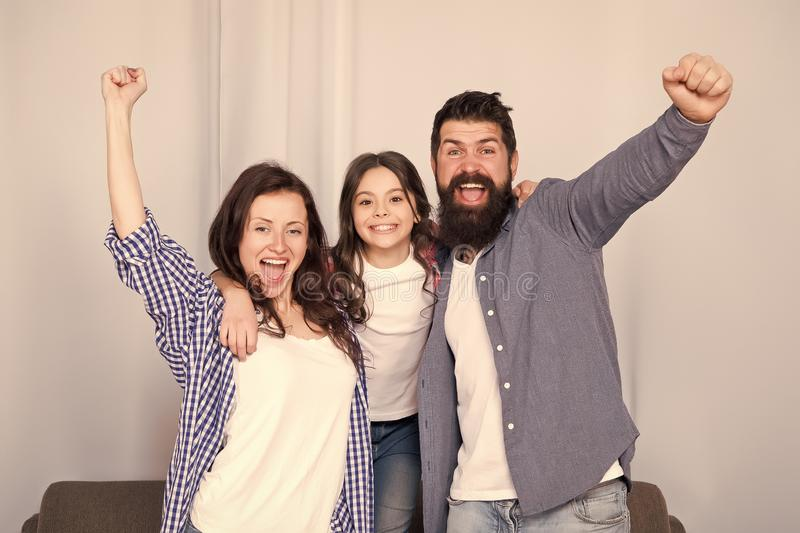 Reunited and it feel so good. Father, mother and happy child at home. Family day. Happy family. Little girl love her. Parents. Bearded man and woman with stock photo