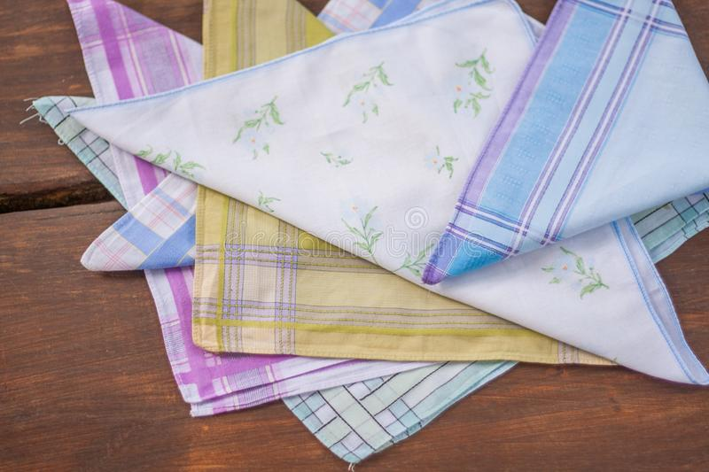 Reusable 100 percent cotton handkerchiefs. Using reusable textile, pure cotton colourful handkerchiefs for blowing nose instead of single use paper tissues stock photos