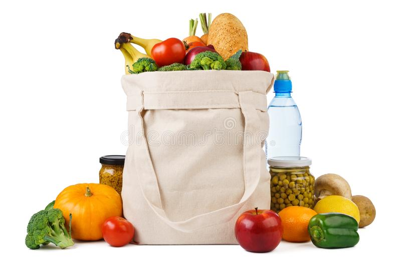 Reusable shopping tote bag full of various groceries. Fruits, vegetables and bread. Isolated on white background, food, grocery, textile, eco, sack, cloth stock image