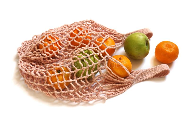 Reusable String Shopping Bag with Apples & Tangerines royalty free stock image