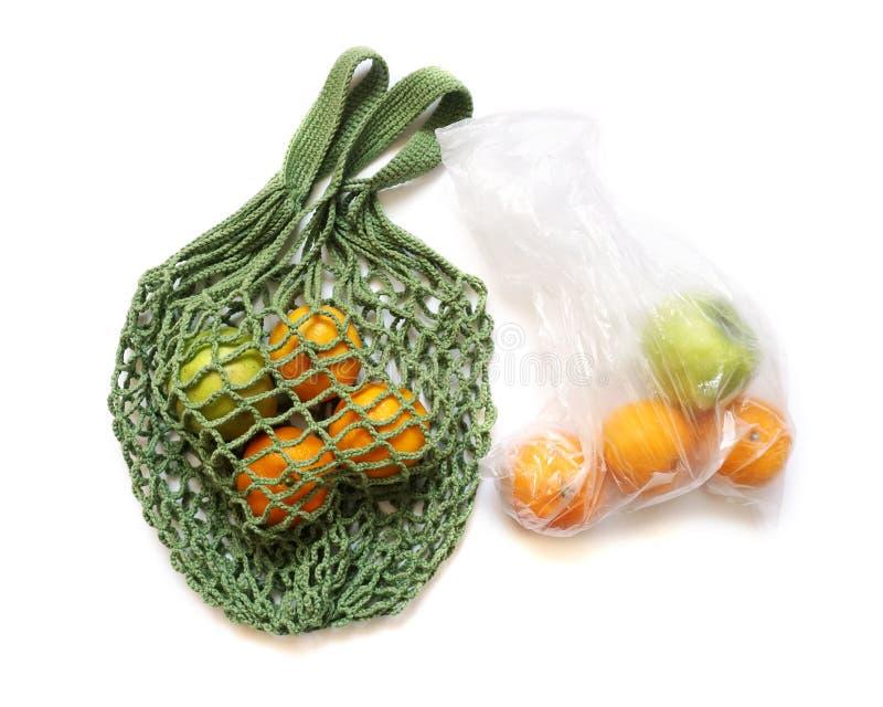 Reusable String Shopping Bag VS Plastic Bag royalty free stock photography