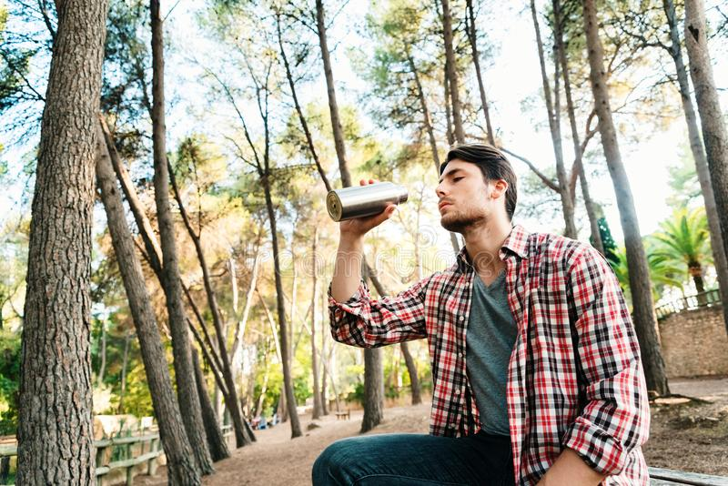 Reusable water bottle held by a man, to avoid the use of plastics.  stock photography