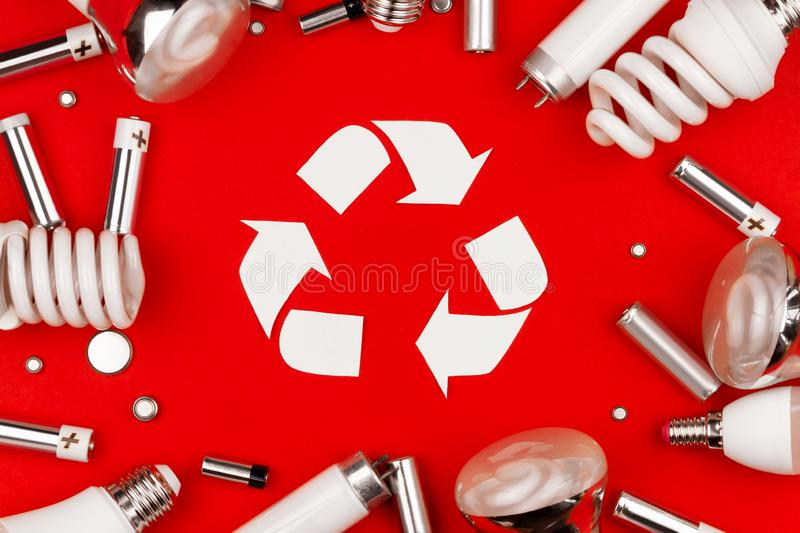 Reuse recycling sign symbol environment light bulbs concept. Old used metal lithium alkaline batteries cells and led, incandescent halogen cfi fluorescent stock photos