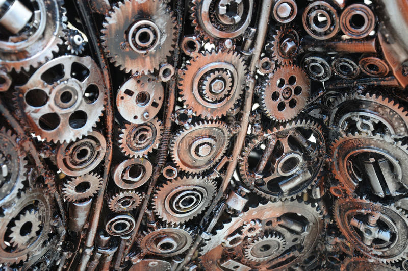 Reusing waste industrial mechanical gears. A photo taken on part of an object made from waste industrial mechanical gears royalty free stock photos