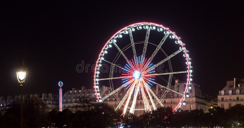Reuzenrad in Parijs bij nacht stock fotografie